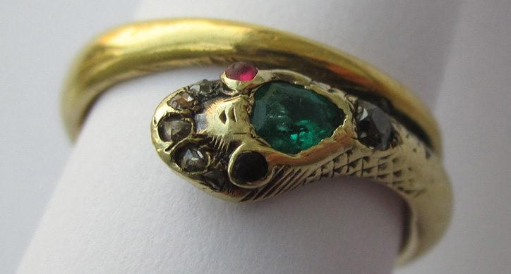 Victorian style yellow gold snake ring with gemstones