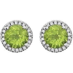 round peridot and diamond halo white gold earrings on a white background