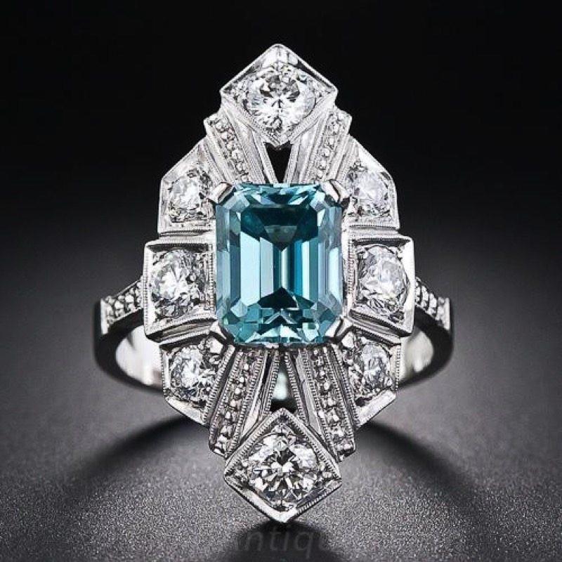 Geometric Art Deco white gold ring with diamonds and gemstone