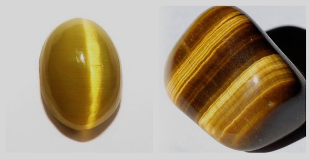 loose oval cabochon cat's eye chrysoberyl and loose free-form tiger's eye quartz on a grey background