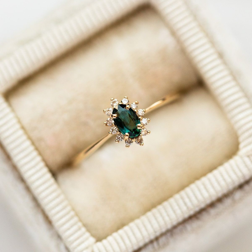Yellow gold oval sapphire and diamond ring in vintage ring box