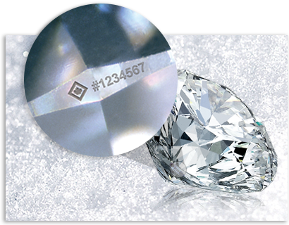Round Canadian diamond with maple leaf and serial number laser inscription on girdle