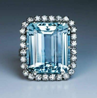 Art Deco emerald cut aquamarine cocktail ring with diamonds