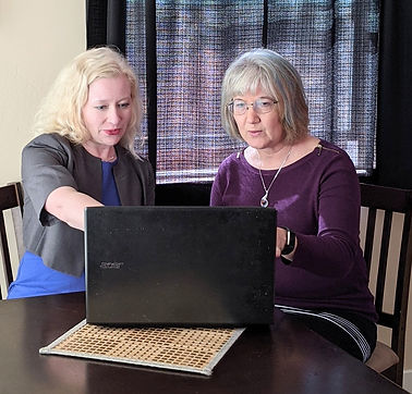 Retail Consultant goes over google anlytics with small business owner.jpg