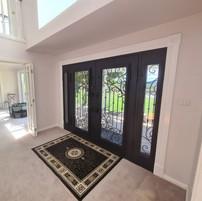 Wrought iron entry door with custom trim