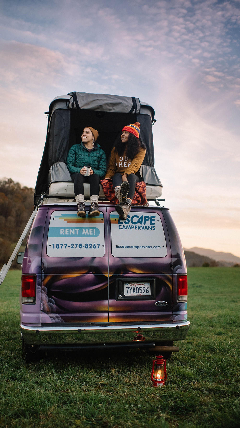 Adriana & Cherisa sitting atop the Campervan at the Far Flung Farm in Canton, NC