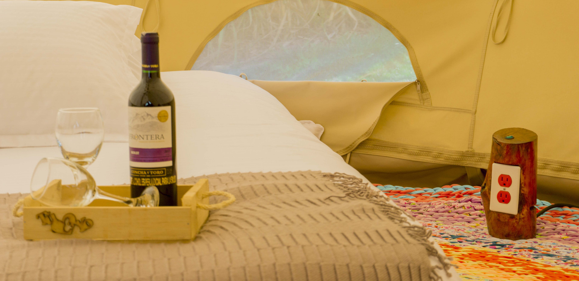 Glamping tent Finca Corazon Wine botle.jpg