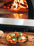 Wood Fired Pizza in front of Oven.JPG