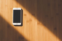 white-apple-iphone-on-wooden-table-48605
