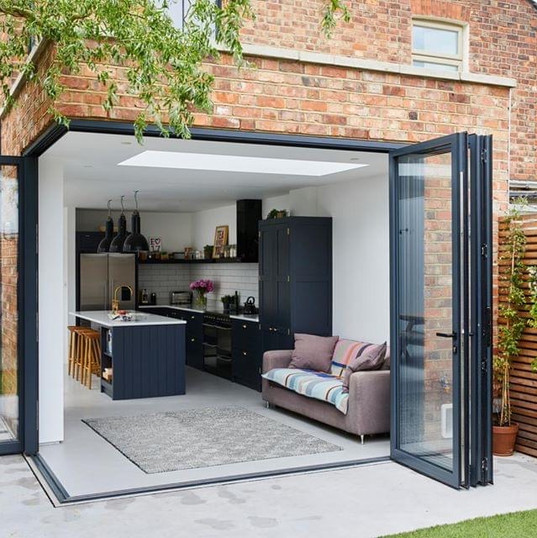 Loving these corner opening doors! - amazing way to open up a room to the outside space.