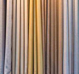 Colorful curtain samples hanging from ha