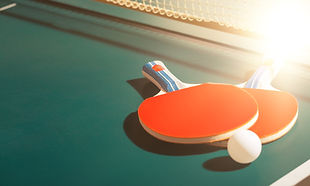 Table Tennis Rackets and Ball on Table w