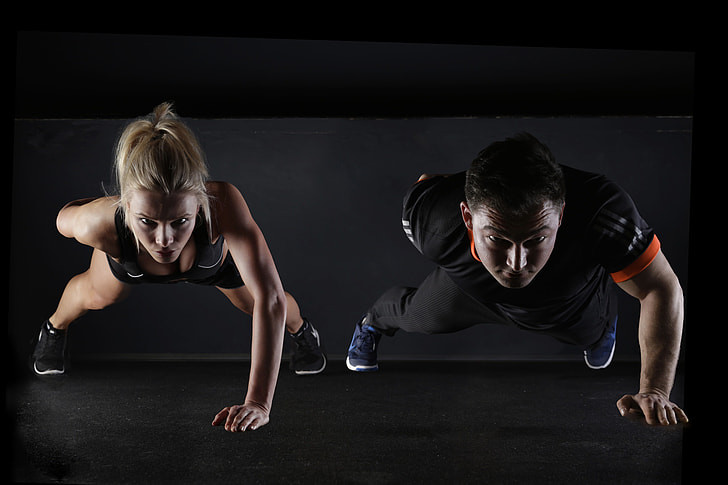 2 people carrying one arm press-ups looking athletic