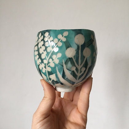 Leafy Cup with Pompom Flowers