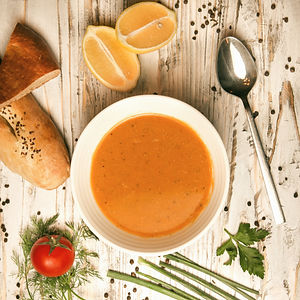 red-lentil-soup-with-lemon-tomato-bread-herbs-spice-spoon-in-a-bowl_edited.jpg