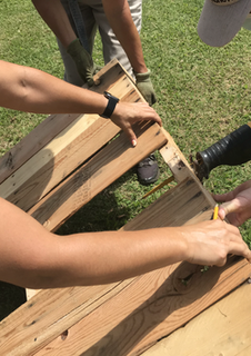 building raised garden beds from recycled pallets at the Na'alehu Community Garden