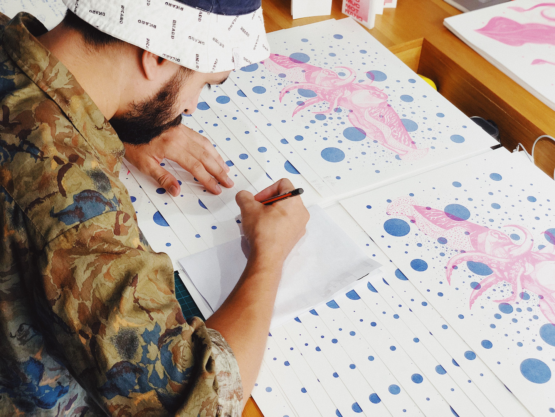 Artist signing risoprints