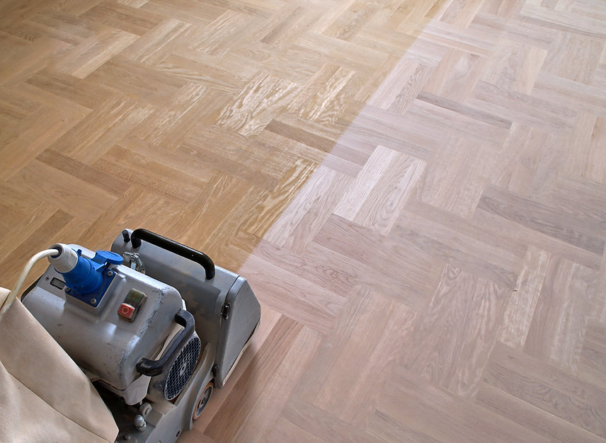 Sanding hardwood floor with the grinding