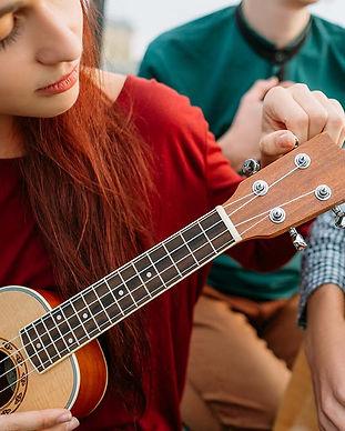 girl-tuning-a-ukulele.jpg