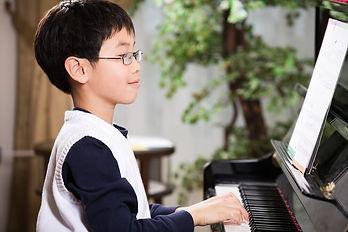boy-playing-piano-resized.jpg