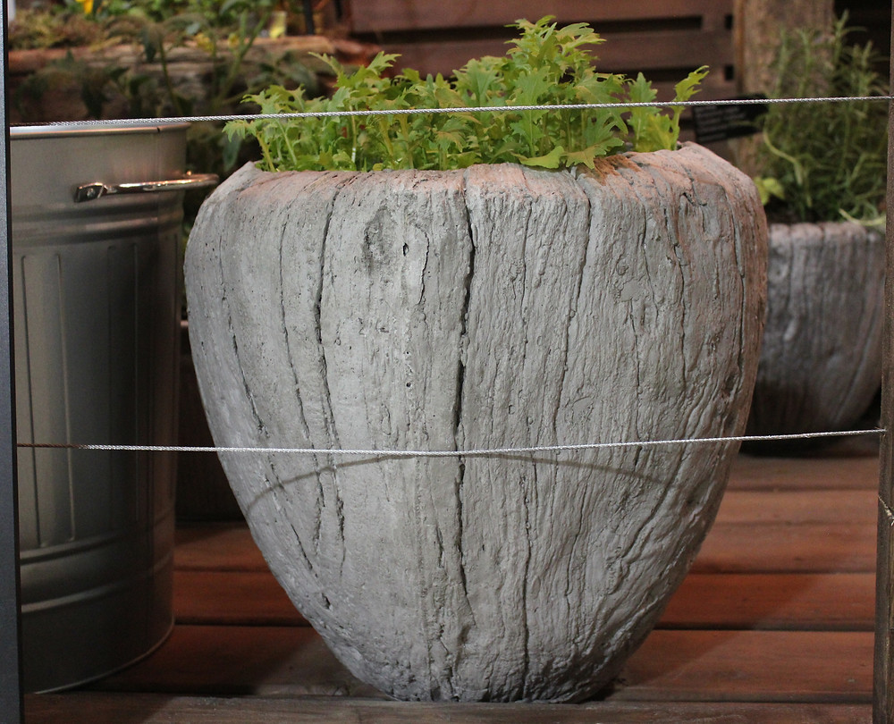 Faux Bois (fake wood) planters are light weight.