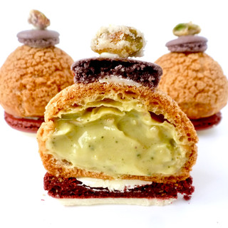 Crispy pistachio choux buns with macaron