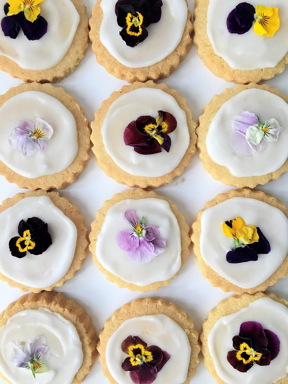 Buttery crumbly shortbread with a lemon icing and edible violas
