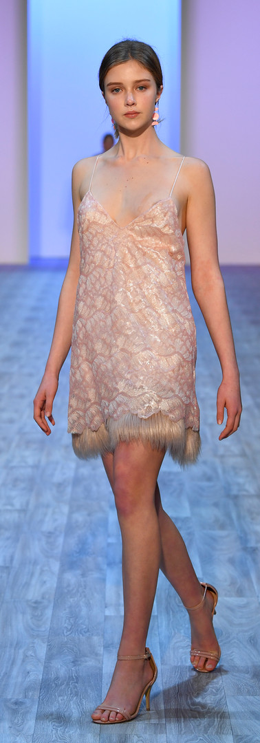 Sequin dress with fur trim Photo by Getty Images