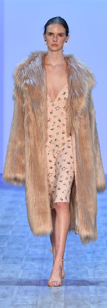 Pink floral slip with faux fur coat. Image by Getty Images