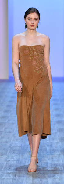Cotton corduroy jumpsuit with corset back and embroidery on front. Photo by Getty Images