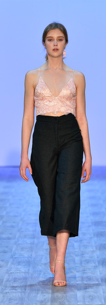 Sequin crop with corset back. Wool 3/4 length pants. Photo by Getty Images