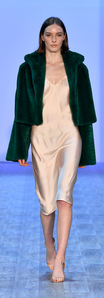 Pink viscose bias slip with faux fur jacket with half moon cut out of back. Photo by Getty Images