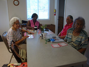 These seniors enjoy their game of bingo in our meal site!