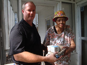 One of our volunteers delivers a meal to one of our homebound seniors.