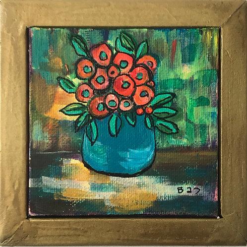 Orange Flowers in Blue Green Pot