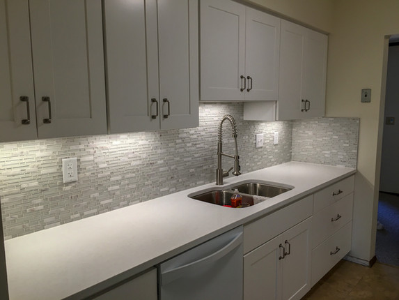 White Shaker Cabinets, Glass Tile Mosaic Backsplash, White Quartz countertops by Cabinetworks Kitchens