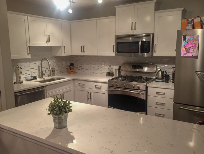 White Shaker Cabinets, Verona Quartz Countertops, Glass Mosaic Backsplash by Cabinetworks Kitchens