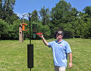 Ted Fixing Feeders Cropped (1).jpg