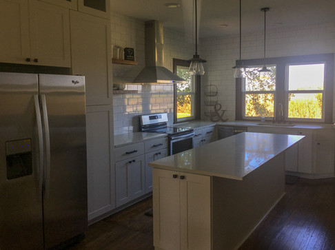 White Shaker Farmouse Cabinets, Custom Island, Marble Quartz Countertops, Open Shelving, Subway Tile Backsplash by Cabinetworks Kitchens