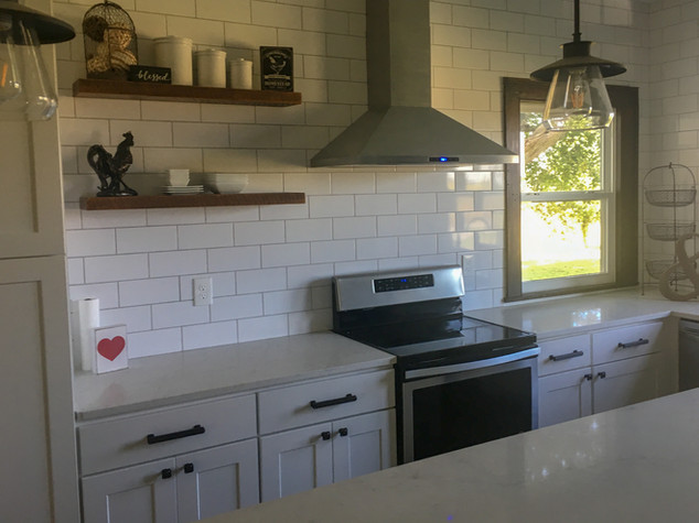 White Shaker Farmouse Cabinets, Marble Quartz Countertops, Open Shelving, Subway Tile Backsplash by Cabinetworks Kitchens