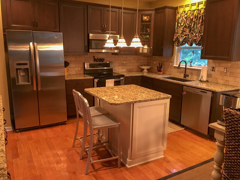Dark Sable Maple Custom Modified Shaker Cabinets, Granite Countertops, Travertine Tile Backsplash
