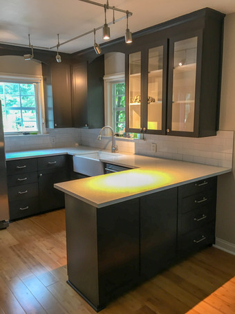 Navy Blue Shaker Glass Cabinets, Quartz Countertops, Subway Tile Backsplash by Cabinetworks Kitchens