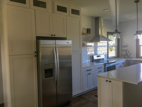 White Shaker Farmouse Cabinets Glass Doors, Marble Quartz Countertops, Open Shelving, Subway Tile Backsplash by Cabinetworks Kitchens
