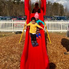 Children play together on the slide