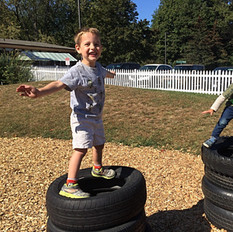 Children climb on a tire structure