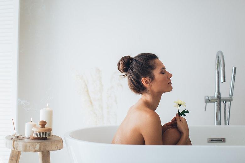 topless-woman-sitting-on-white-ceramic-b