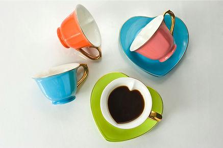 multi-colored heart shaped teacup set