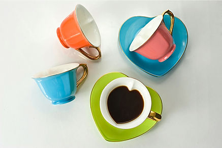 multi-colored heart shaped teacup set