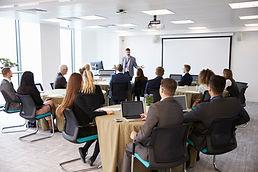 businessman-making-presentation-at-confe