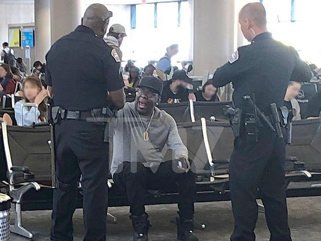 Image result for bobby brown kicked off plane